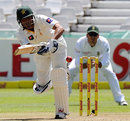 Younis Khan drives the ball to the leg side