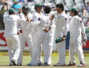 Saeed Ajmal is congratulated by his team-mates, South Africa v Pakistan, 2nd Test, Cape Town, 2nd day, February 15, 2013