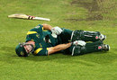 Shaun Marsh writhes in pain after hurting his knee completing the run for his hundred, Australia A v England Lions, Hobart, February 16, 2013