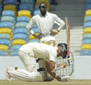 Tagenarine Chanderpaul uses the bail to take guard