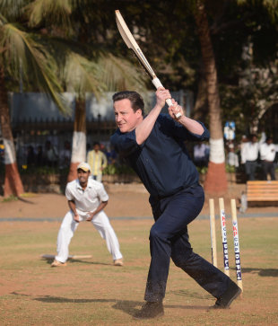 David Cameron plays cricket during a trip to India, Mumbai, February 18, 2013