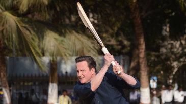 David Cameron plays cricket during a trip to India