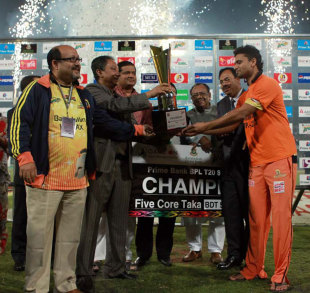 Mashrafe Mortaza receives the BPL trophy after Dhaka Gladiators beat Chittagong Kings in the final in Mirpur