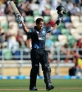 Ross Taylor raises his bat after completing his seventh ODI hundred