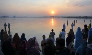 Devotees offer prayers to the sun during the Chhath festival on the banks of the Hussain Sagar lake, Hyderabad, November 19, 2012