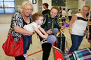 Australia's Sarah Coyte enjoying time with her family upon her arrival from the Women's World Cup
