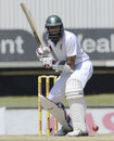Hashim Amla is poised to play the ball