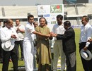 BCB chief Nazmul Hassan holds the pink ball ahead of the day-night BCL final