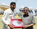 Harbhajan Singh receives a memento from N Srinivasan on playing his 100th Test, India v Australia, 1st Test, Chennai, 1st day, February 22, 2013