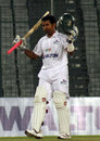 Raqibul Hasan acknowledges the crowd after reaching his century