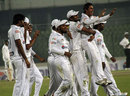 Central Zone's Mohammad Ashraful is lifted by a team-mate after taking a hat-trick against North Zone