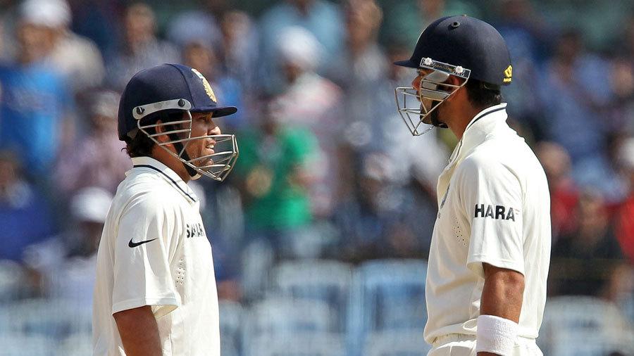 Sachin Tendulkar and Virat Kohli chat during their 91-run stand