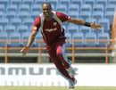 Dwayne Bravo celebrates on his way to 6 for 43
