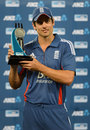 Alastair Cook poses with the series trophy