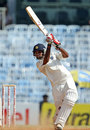 Bhuvneshwar Kumar drives during his fighting 38