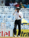 Umpire Kumar Dharmasena calls for a replacement ball, India v Australia, 1st Test, Chennai, 4th day, February 25, 2013
