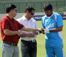 Shahriar Nafees looks at his injured hand at training, Mirpur, February 26, 2013