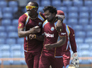 Veerasammy Permaul is congratulated by his captain Dwayne Bravo after a strike, West Indies v Zimbabwe, 3rd ODI, Grenada, February 26, 2013