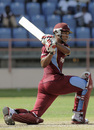 Kieran Powell sweeps during his 42, West Indies v Zimbabwe, 3rd ODI, Grenada, February 26, 2013