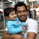 Mushfiqur Rahim with Mahmudullah's son before departing for Sri Lanka