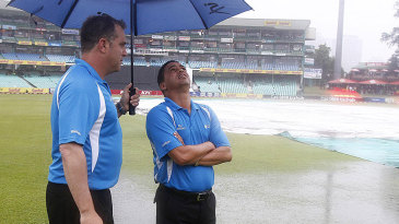 Umpires Adrian Holdstock and Shaun George take stock of the ground at Durban, South Africa v Pakistan, 1st T20I, Durban, March 1, 2013