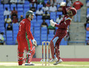 Brendan Taylor is caught behind by Denesh Ramdin