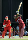 Dwayne Bravo launches one through the offside, 1st T20I, North Sound, March 2, 2013