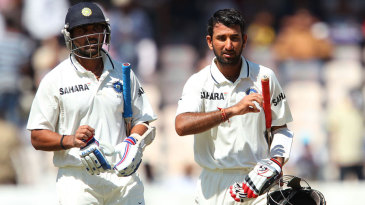 M Vijay and Cheteshwar Pujara leave the field during the tea break