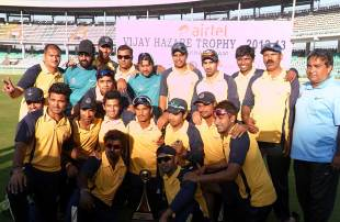 The victorious Delhi team with the Vijay Hazare Trophy