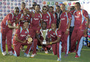 The victorious West Indies team pose with the trophy after winning the Twenty20 series against Zimbabwe, West Indies v Zimbabwe, 2nd T20I, Antigua, March 3, 2013