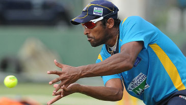 Chanaka Welegedara catches a ball during a practice session in Galle