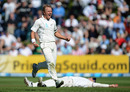 Hamish Rutherford lies on the ground behind Neil Wagner after taking a catch