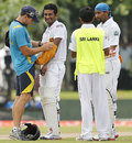 Dimuth Karunaratne gets treatment on his left arm, Sri Lanka v Bangladesh, 1st Test, Galle, 1st day, March 8, 2013