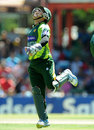 Kamran Akmal jumps for joy after taking a catch