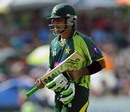Mohammad Hafeez leaves the field after being run out