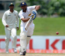 Tillakaratne Dilshan drives down the ground