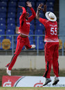 Sunil Narine and Kieron Pollard celebrate the fall of a wicket