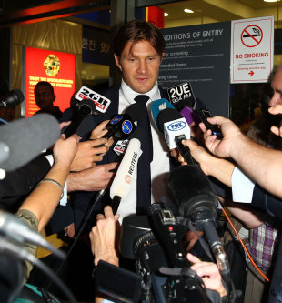 Shane Watson is swarmed by reporters in Sydney, March 12, 2013