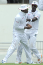 Marlon Samuels is congratulated by Darren Sammy for taking a stunner at gully