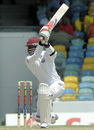 Marlon Samuels goes through the off side