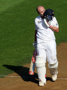 Jonathan Trott kisses his helmet after reaching his century