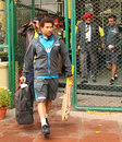 Sachin Tendulkar and members of the Indian team leave the stadium after the first day's play was washed out