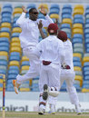 Shane Shillingford celebrates the wicket of Malcolm Waller