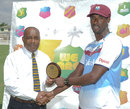 Shane Shillingford is presented with the Man-of-the-Match award, West Indies v Zimbabwe, 1st Test, Barbados, 3rd day, March 14, 2013