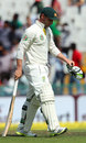 Phillip Hughes walks back after being dismissed, India v Australia, 3rd Test, Mohali, 2nd day, March 15, 2013