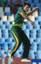 Mohammad Irfan reacts after taking a wicket