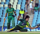 Mohammad Irfan plucks a catch one-handed off his own bowling