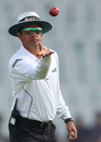 Umpire Aleem Dar takes the new ball