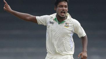 Abul Hasan celebrates the wicket of Dimuth Karunaratne