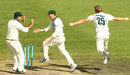 James Faulkner and teammates George Bailey and Ricky Ponting celebrate the fall of a wicket
